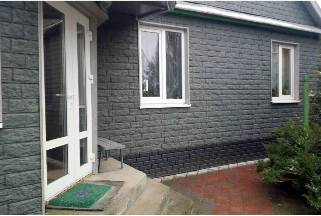 Фасадные панели под камень: свойства, достоинства и недостатки