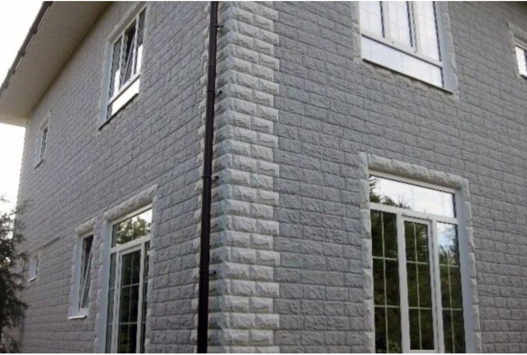 Обшивка загородного дома из газобетона фасадными панелями